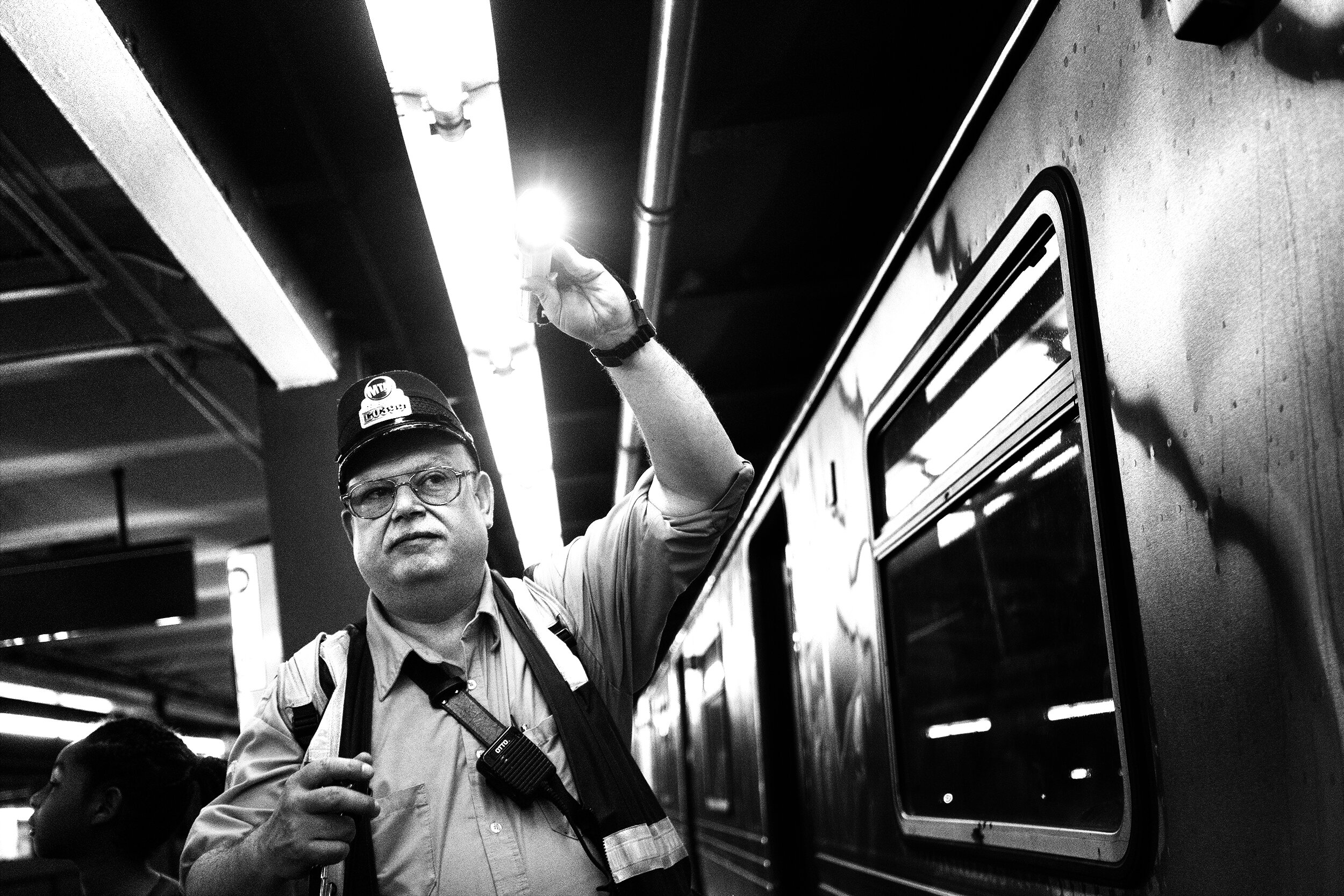 Brklyn_Subway_2018_Conductor_With_Flash_Light-009crp.jpg