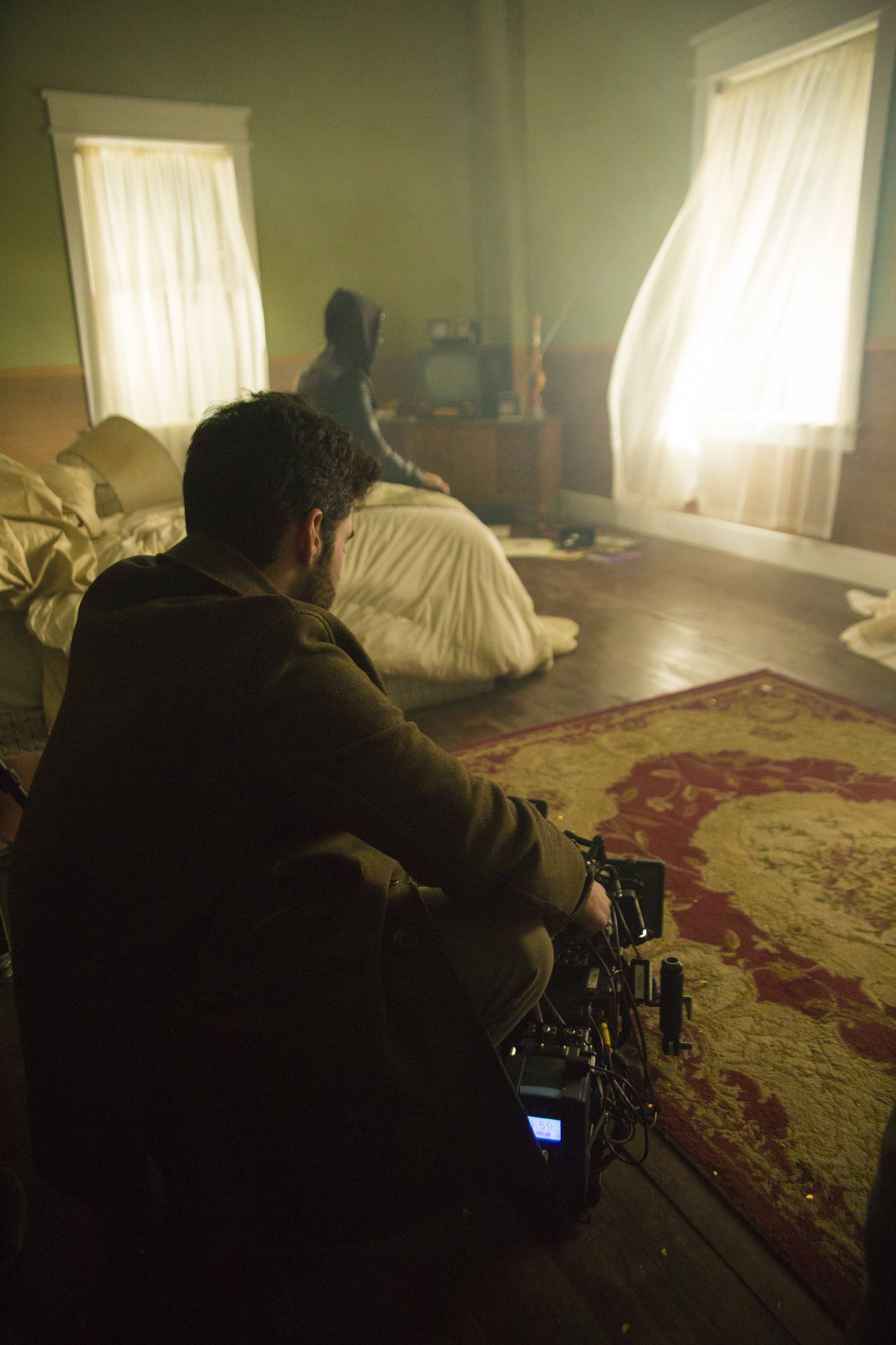 Matt Bendo composing a shot on the set of Mind Games Photo Credit - Samuel Pollock