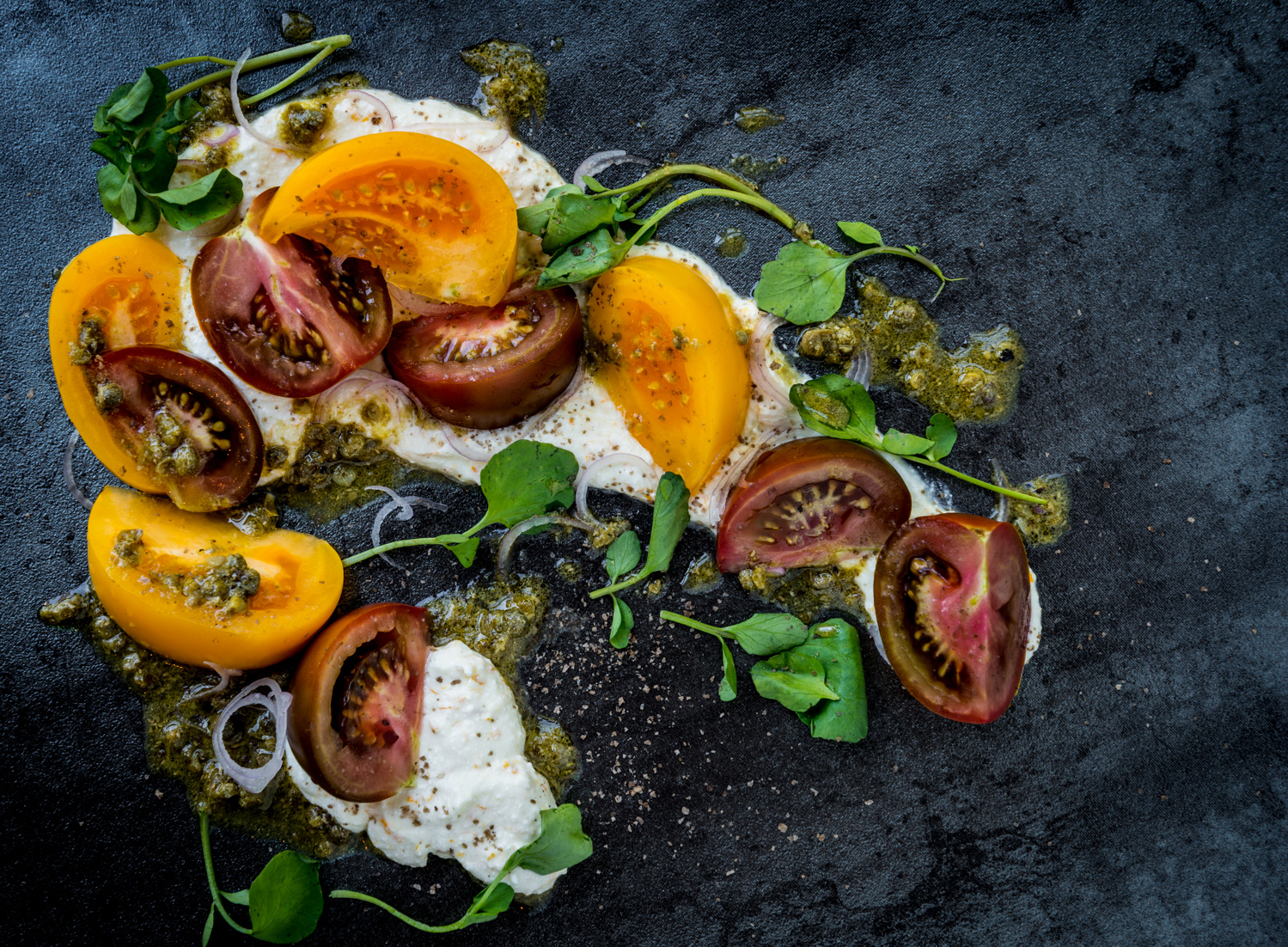 In the spirit of Campania, Italy  : Heirloom tomatoes, Meyer lemon ricotta, watercress, caper vinaigrette, shallot, smoked sea salt : Pair with Falanghina, Fiano or Greco from Campania, Italy