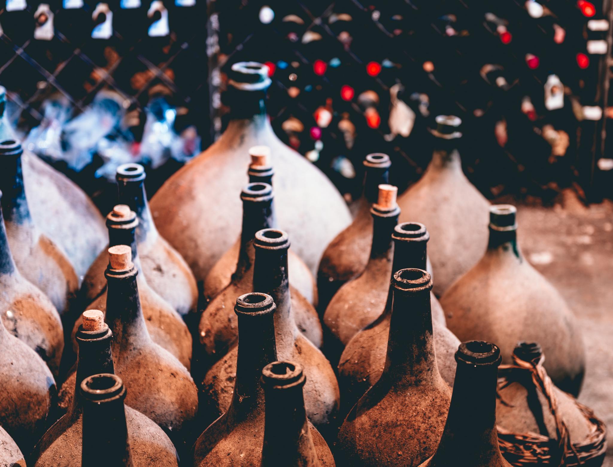 Italy : Piedmont : Demijohns in the cellar at Bartolo Mascarello in Barolo