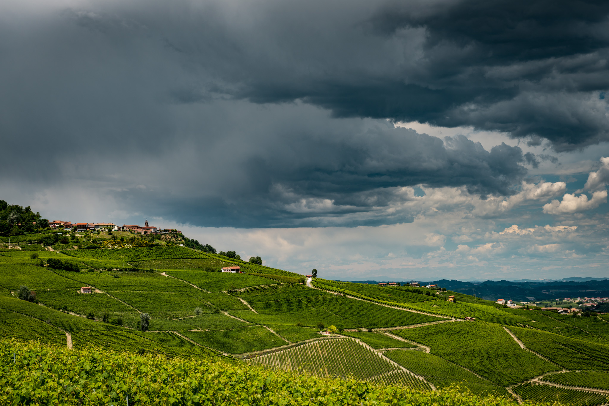 Italy : Piedmont : Storm clouds rolling in over Barolo