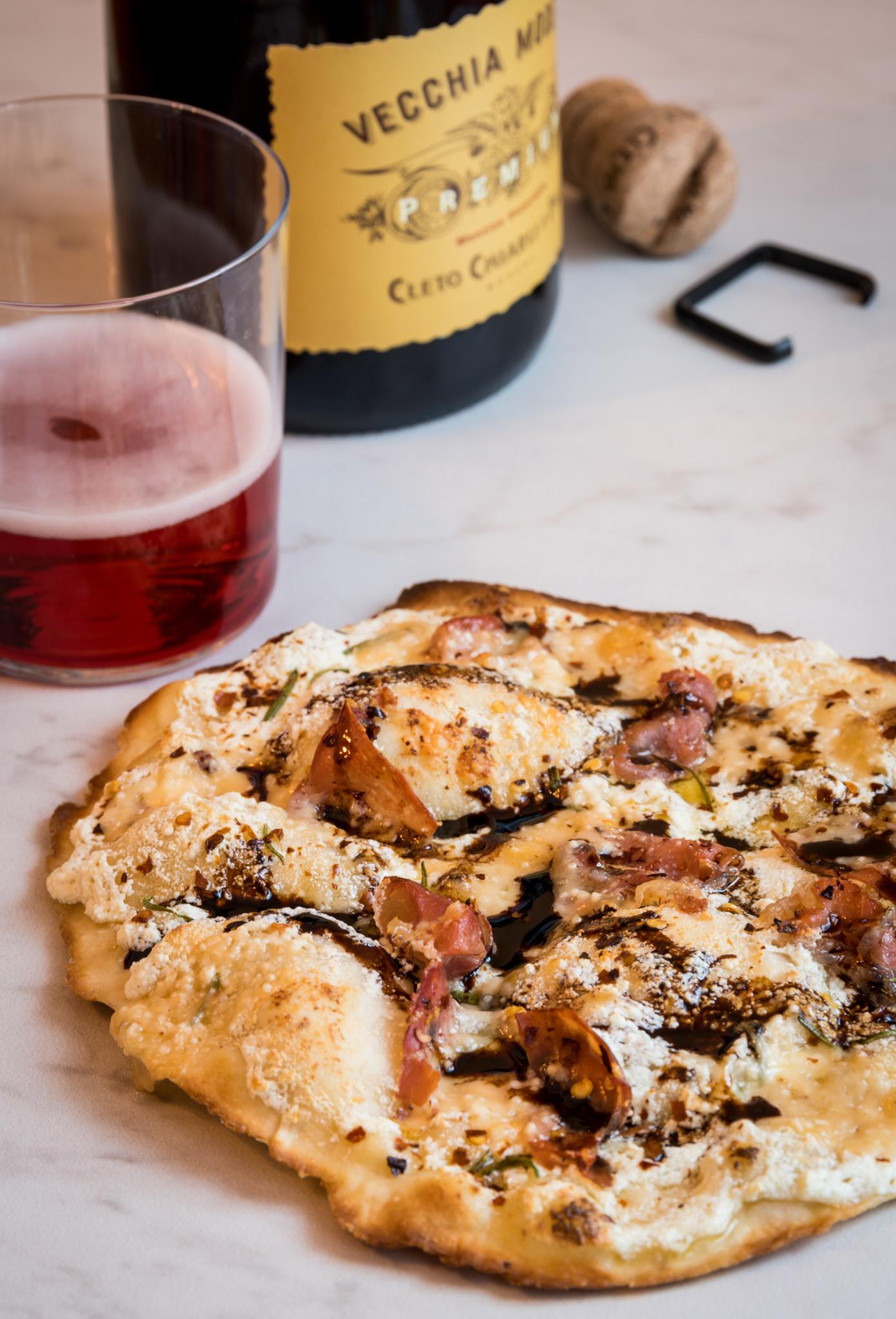 """In the spirit of Emilia-Romagna, Italy  : Pizza with ricotta and olive oil base, Parmigiano-Reggiano, Prosciutto di Parma, rosemary, Aceto Balsamico di Modena : Paired with Cleto Chiarli """"Vecchia Modena"""" Lambrsuco"""