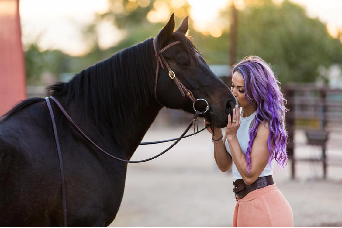 Purple hair don't care: personal trainer, competitive bodybuilder, and dairy farmer Courtney Newhall-Caballero.