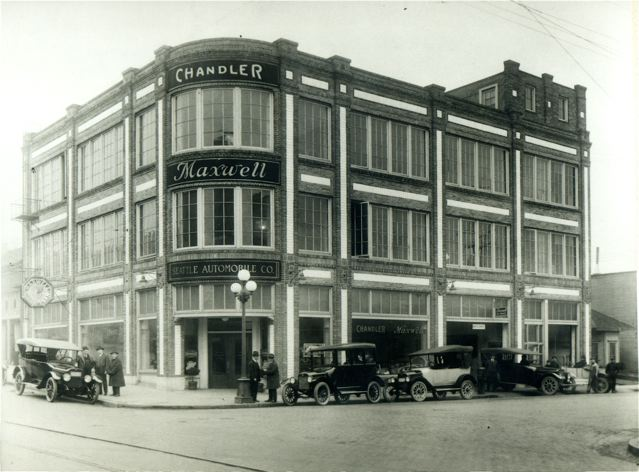 Historical photo of the Baker Linen Building, the current location of Retrofit Home on the corner of Pike Street and 11th Street.