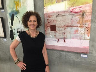 Lisa Lightman in front of her paintings at The Laundry gallery with me though Nov. 27.