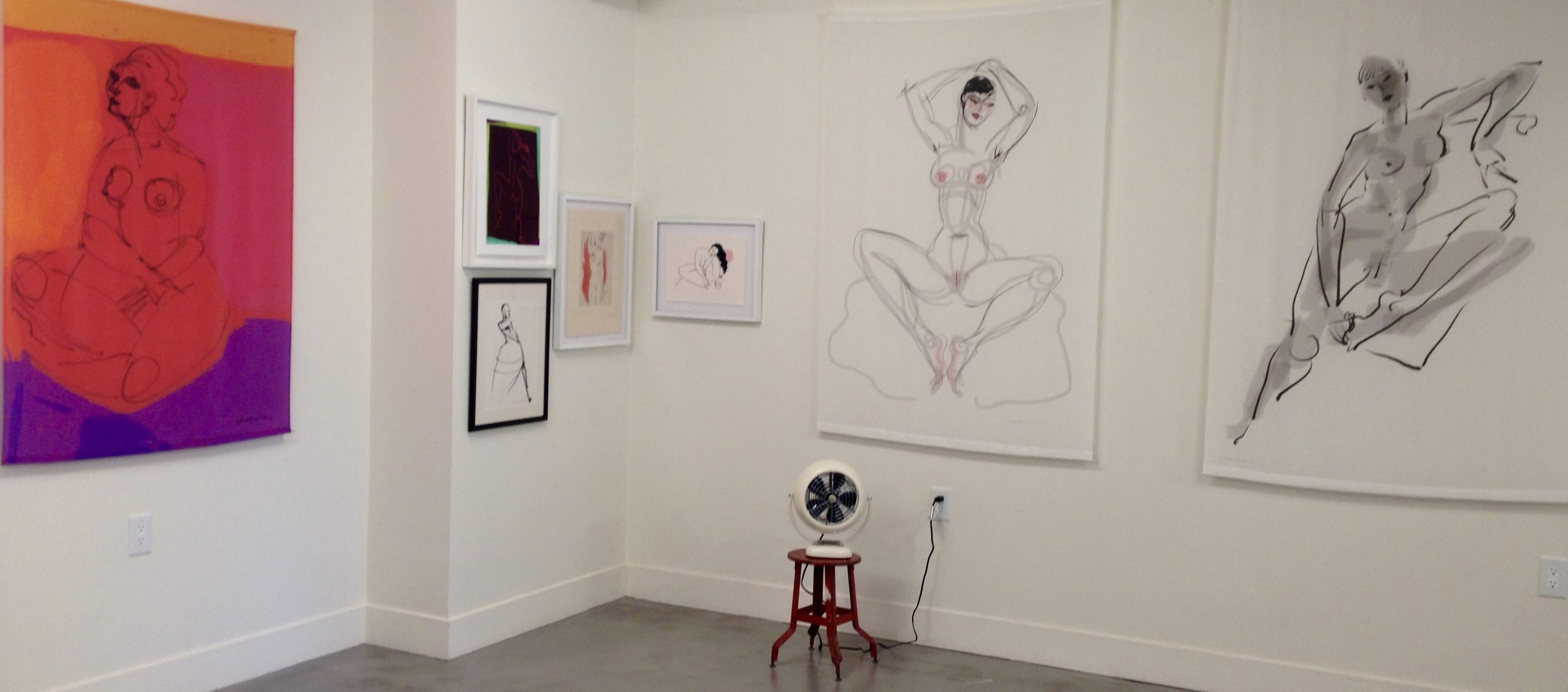 One of my corners of the gallery showing a color block silk scroll (left), two of my white silk scrolls (right), three of my prints and a drawing (center) Plus the fan.   November 2016