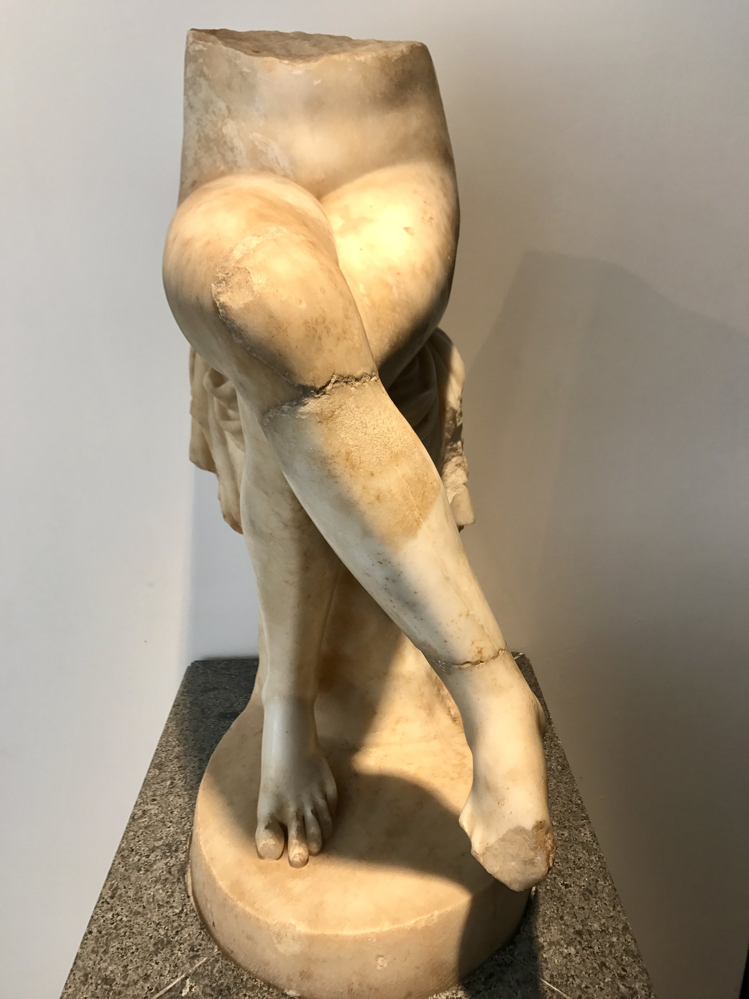 I don't recall seeing much ancient sculpture with simple, perfect, naked crossed legs.