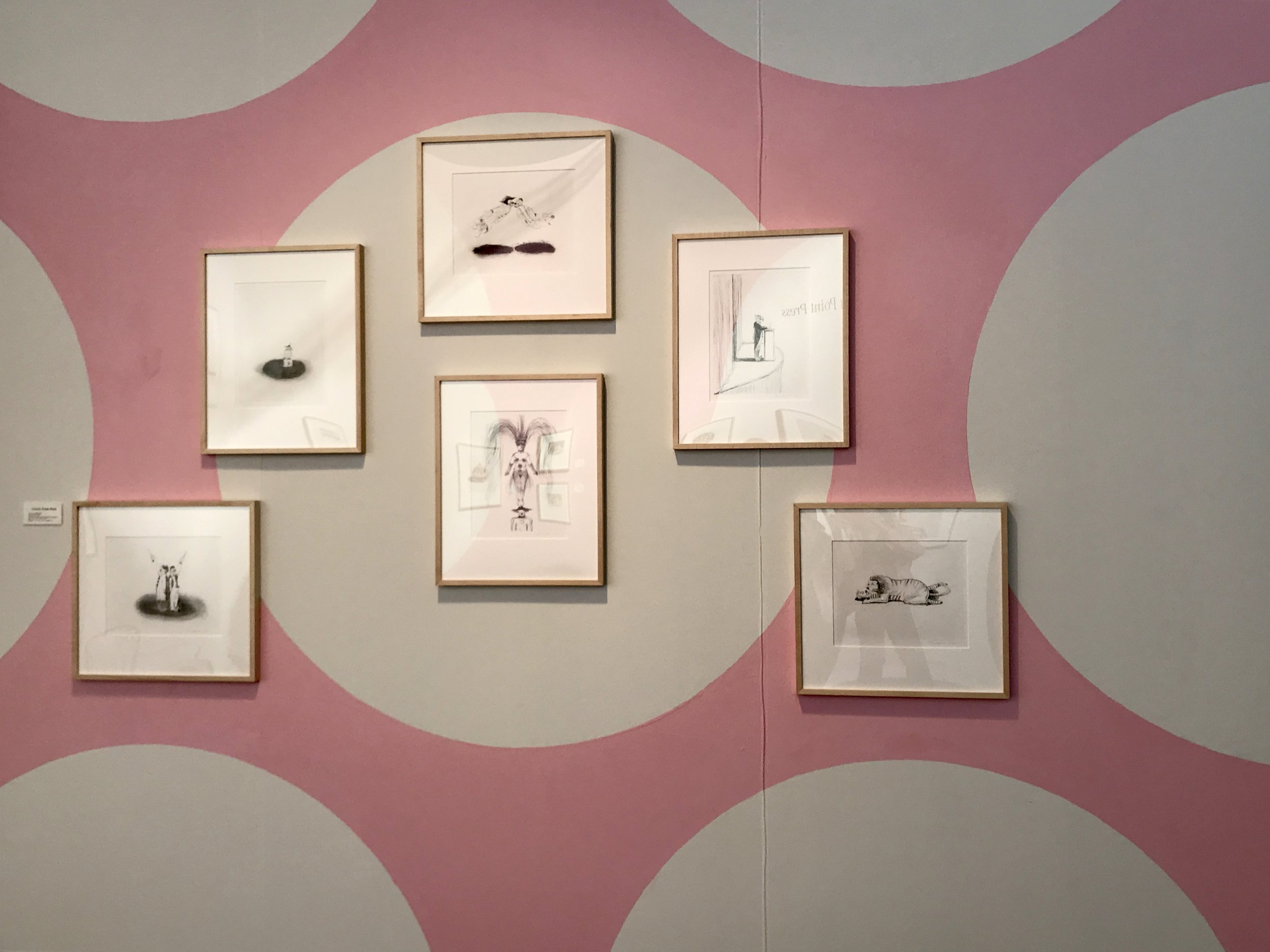 A painted pink dot wall makes for a delightful background for these perfect prints at Fog.