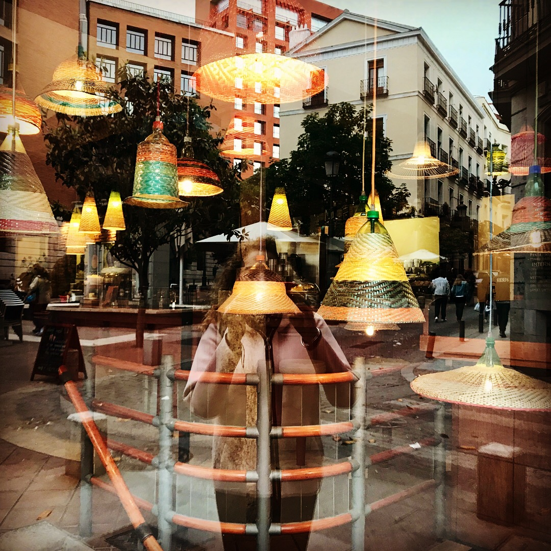 Selfie with reflections of Madrid in a groovy fixture store window. I'm wearing a pastel pink neoprene jacket from a shop in Girona.