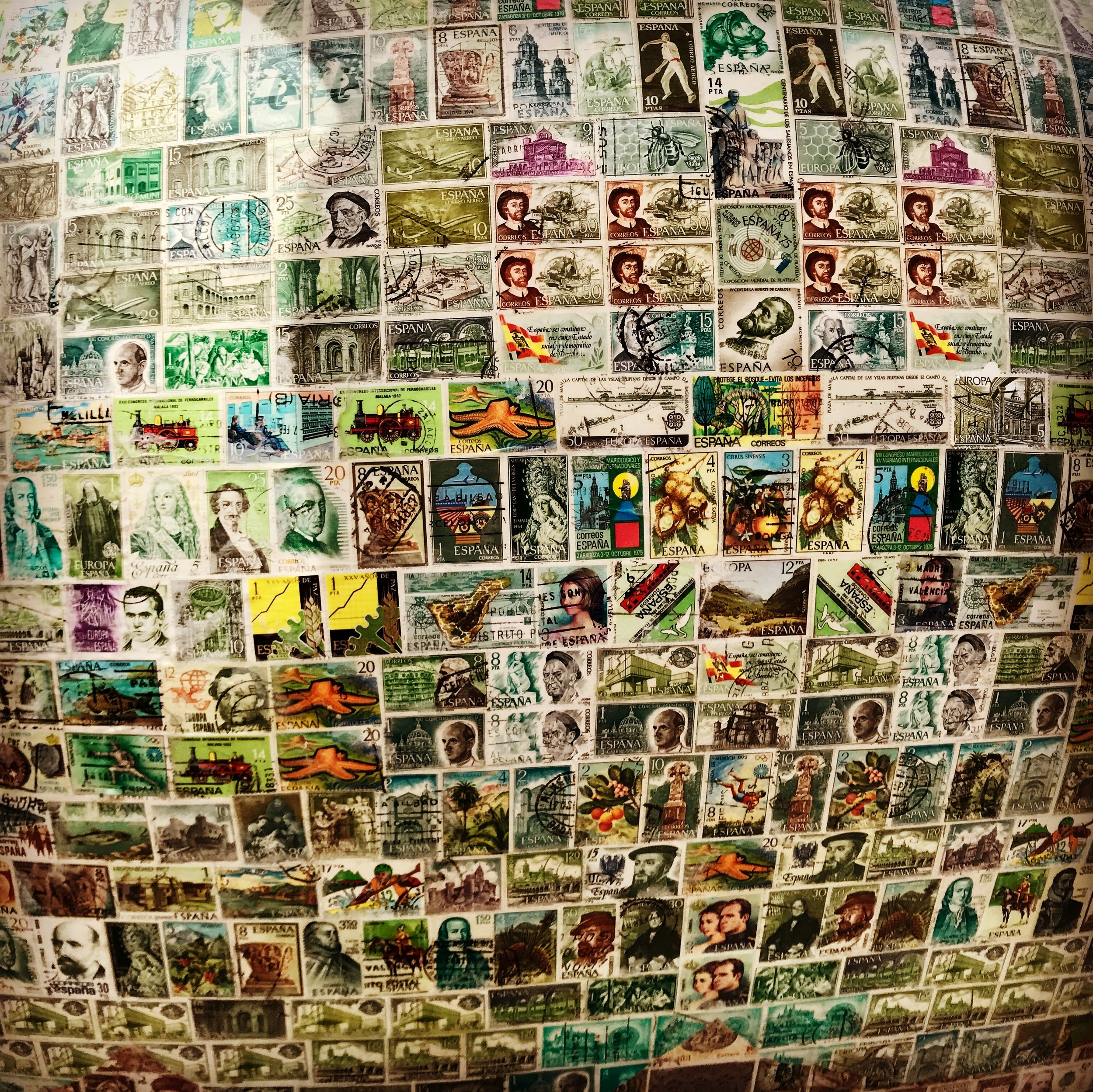 Close-up of one of Madrid's artist-made statues (there are many different ones all around town)- a collage of Spanish stamps.