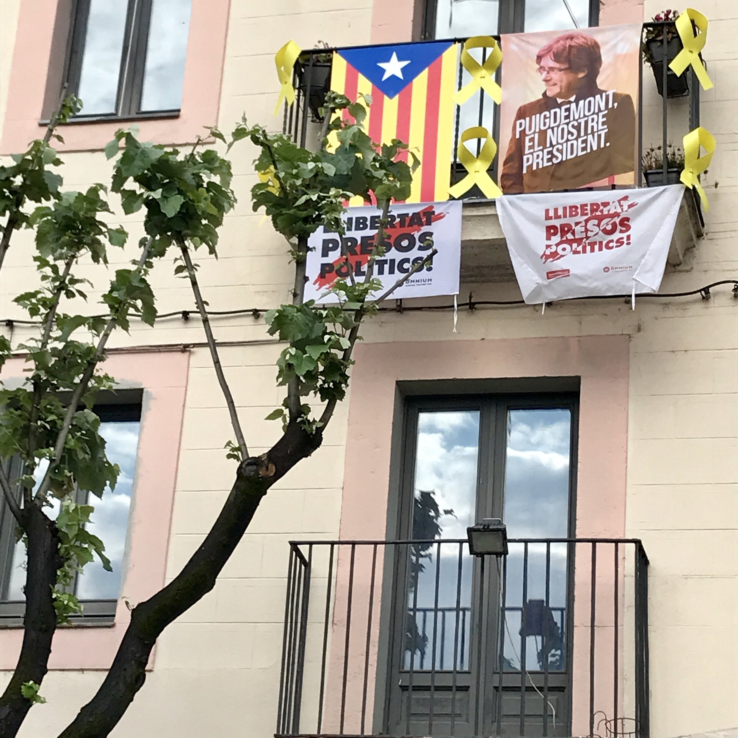 You know that you're in Catalonia when you see the Catalan flags, yellow ribbons, and independence posters.