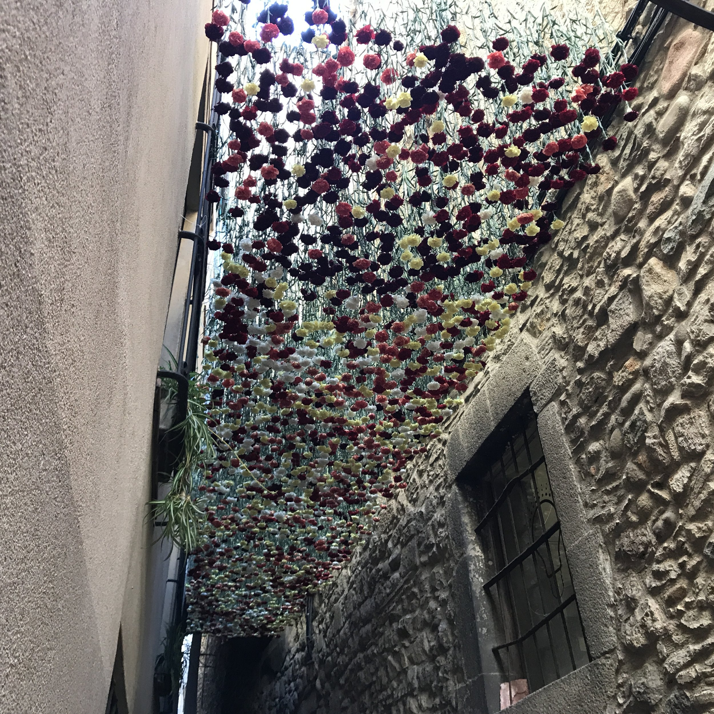 Flowers festoon the the old Jewish Quarter (Call). It is one of the best preserved in Europe.