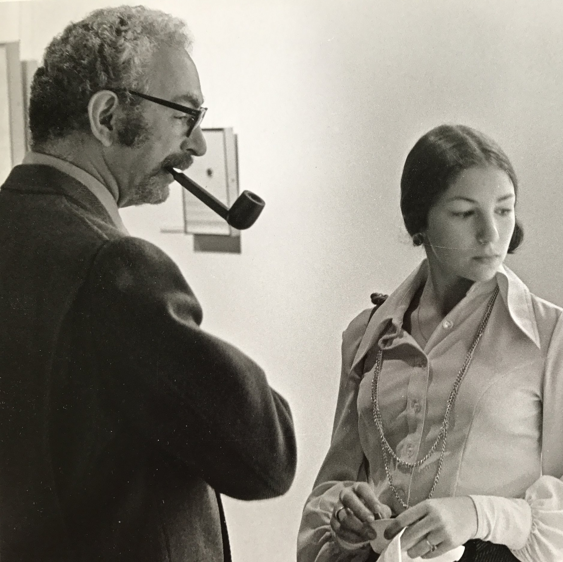 As a teenager with my father in our art school gallery.