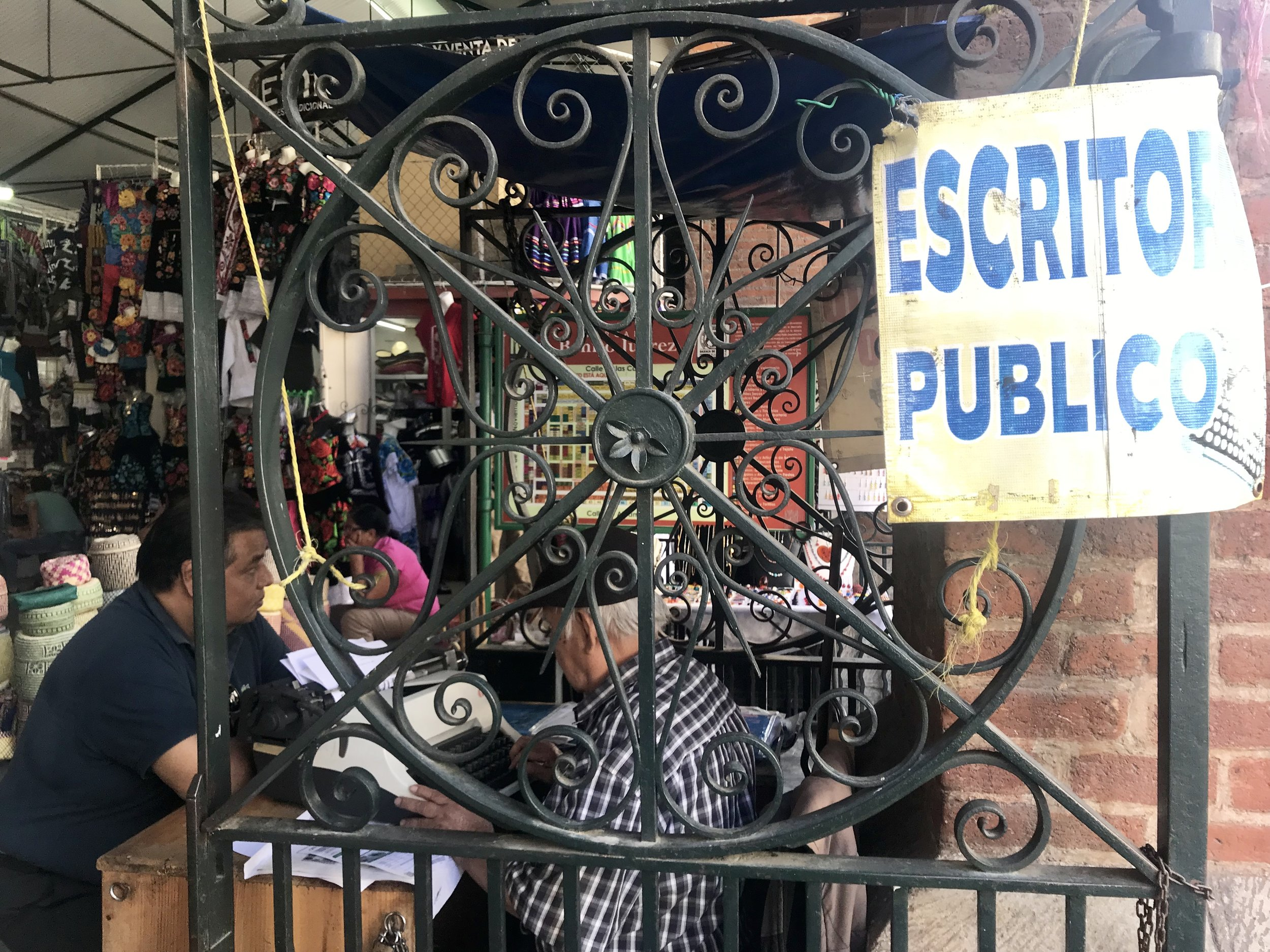 This fellow surprised me: An older man with a manual typewriter in a Oaxaca City market, writing a letter for a customer.
