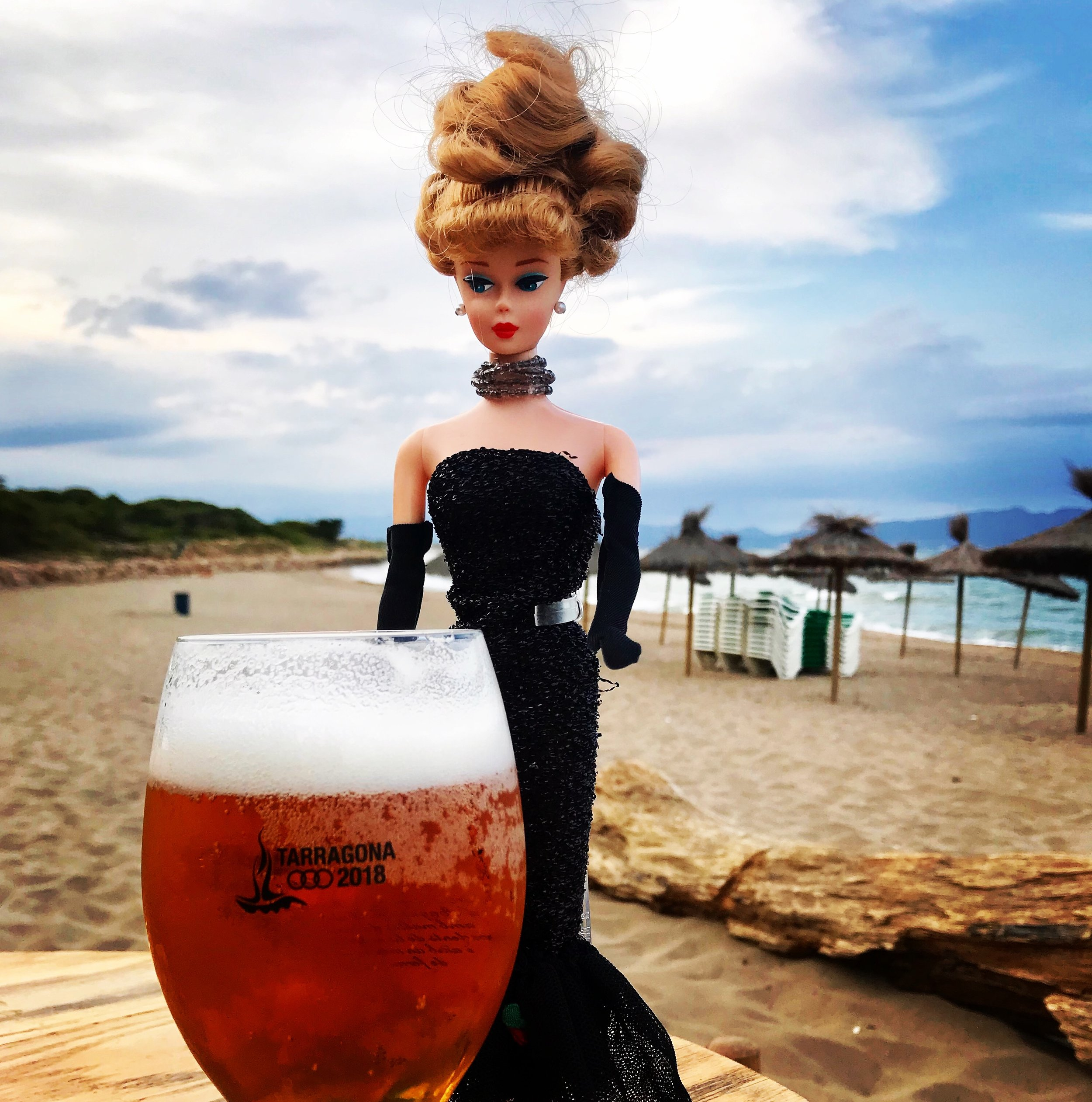 Barbie having a beer at the beach. It's the perfect way to end the day here.