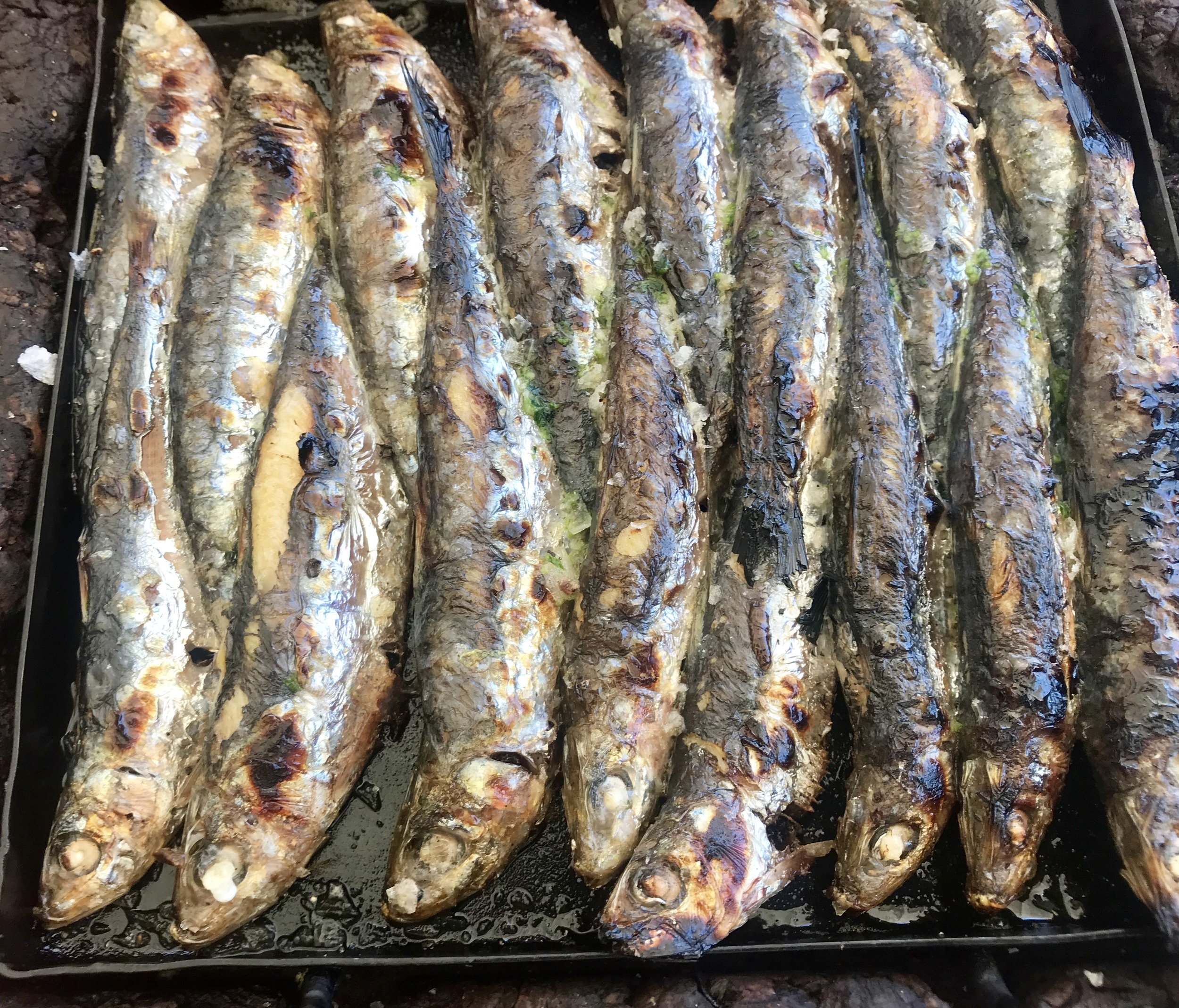 Lunch at the beach starts with these perfectly grilled sardines - so fresh and delicate.