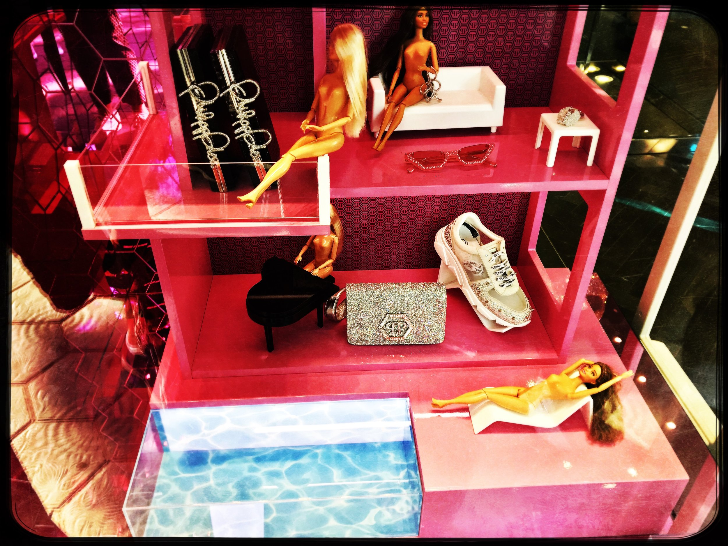 Barbie's friends - a bunch of new, naked Barbies dominate a shoestore display in Barcelona.