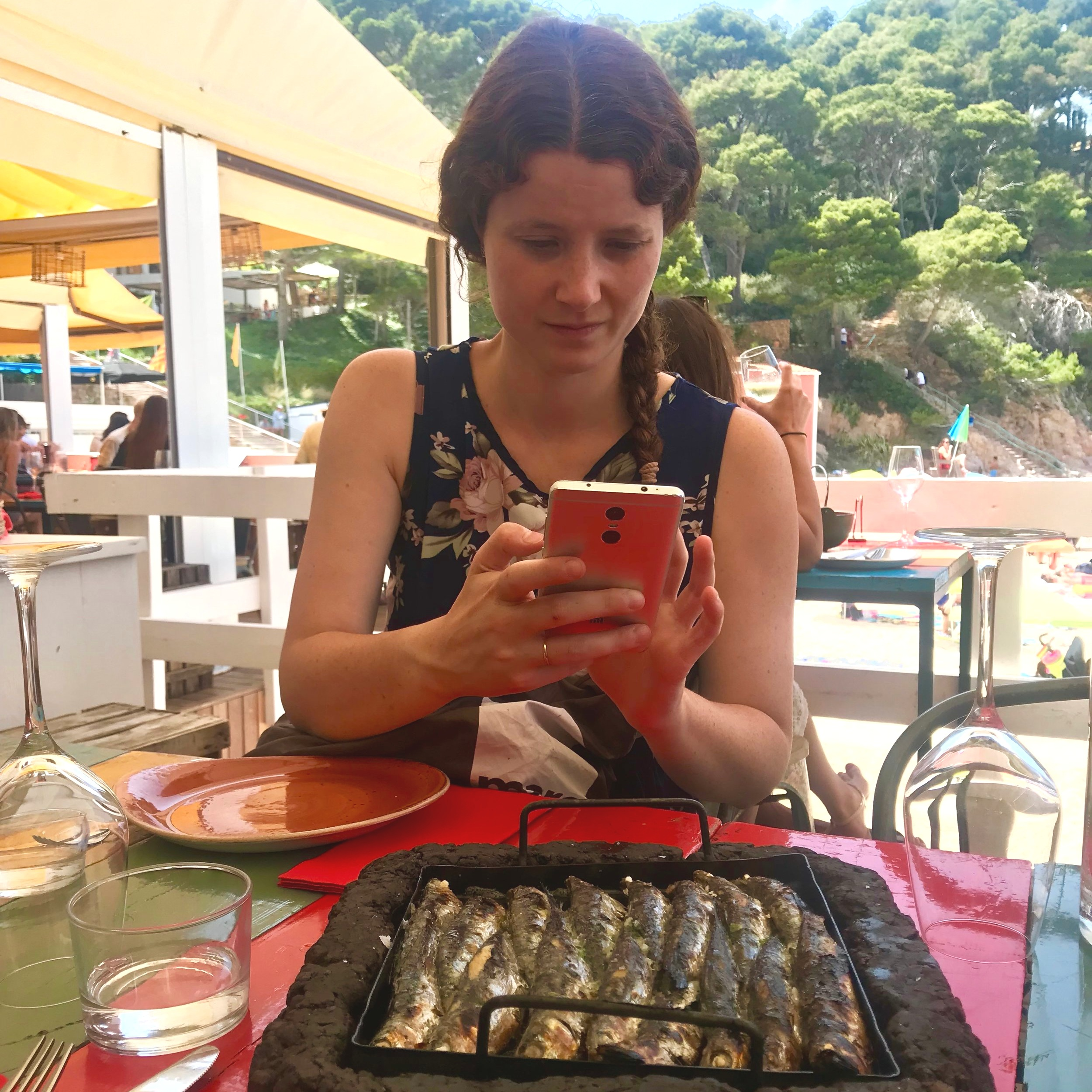 Valentina Instagraming our sardine lunch.