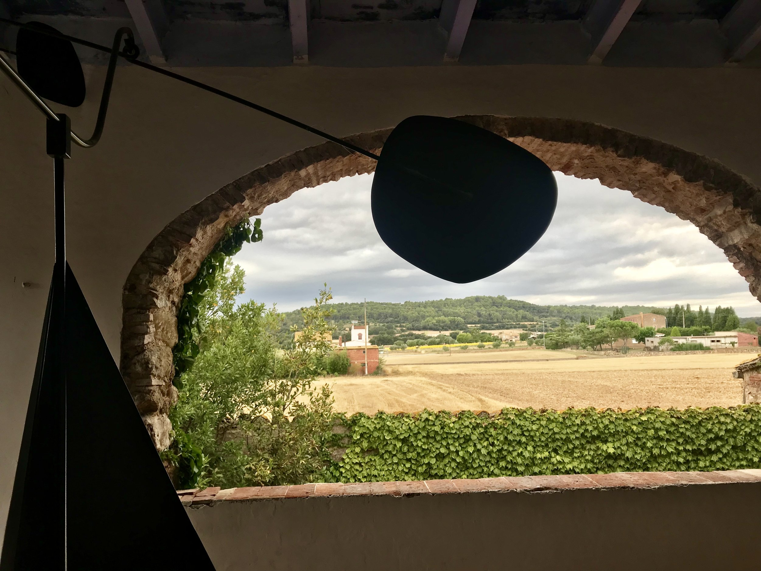 Catalan village arch opens out to farmland