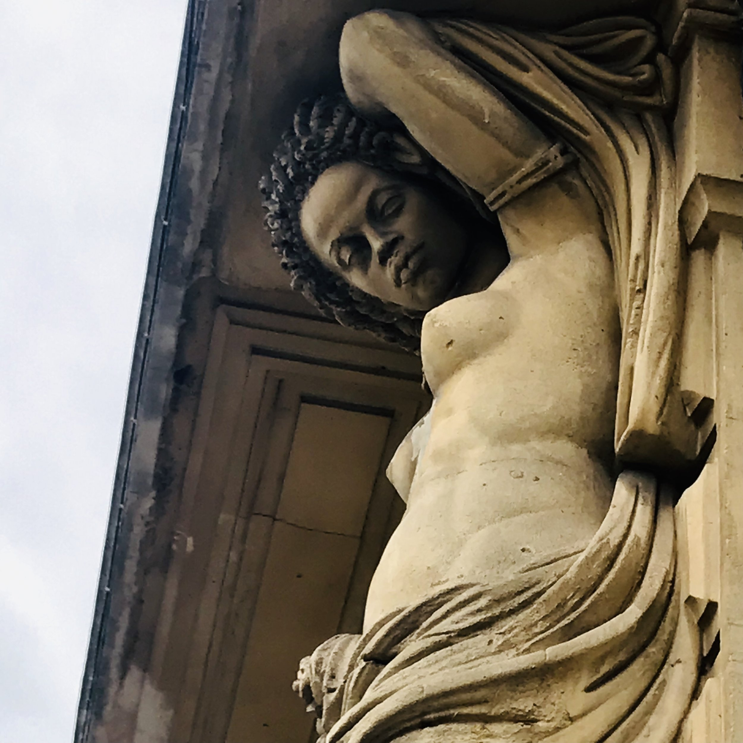 Beautiful, realistic, and surprising statues adorning an old building (Sete)