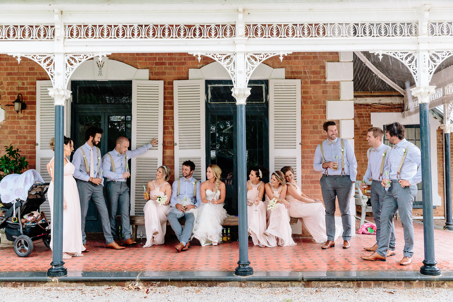 Bridal Party sheltering from the rain on the verandah of the homestead at Perricoota Station