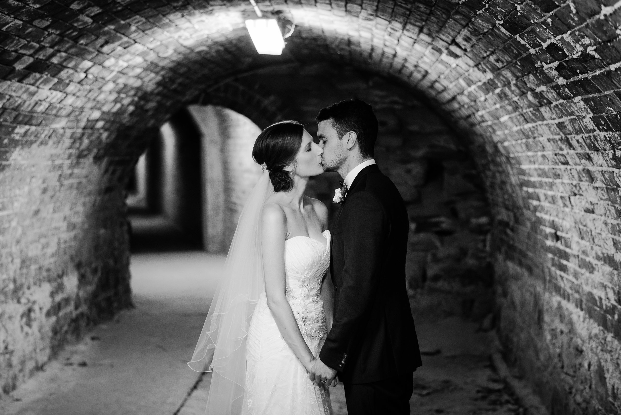 Bride and Groom kissing in the secret tunnels under Fortuna Villa Bendigo