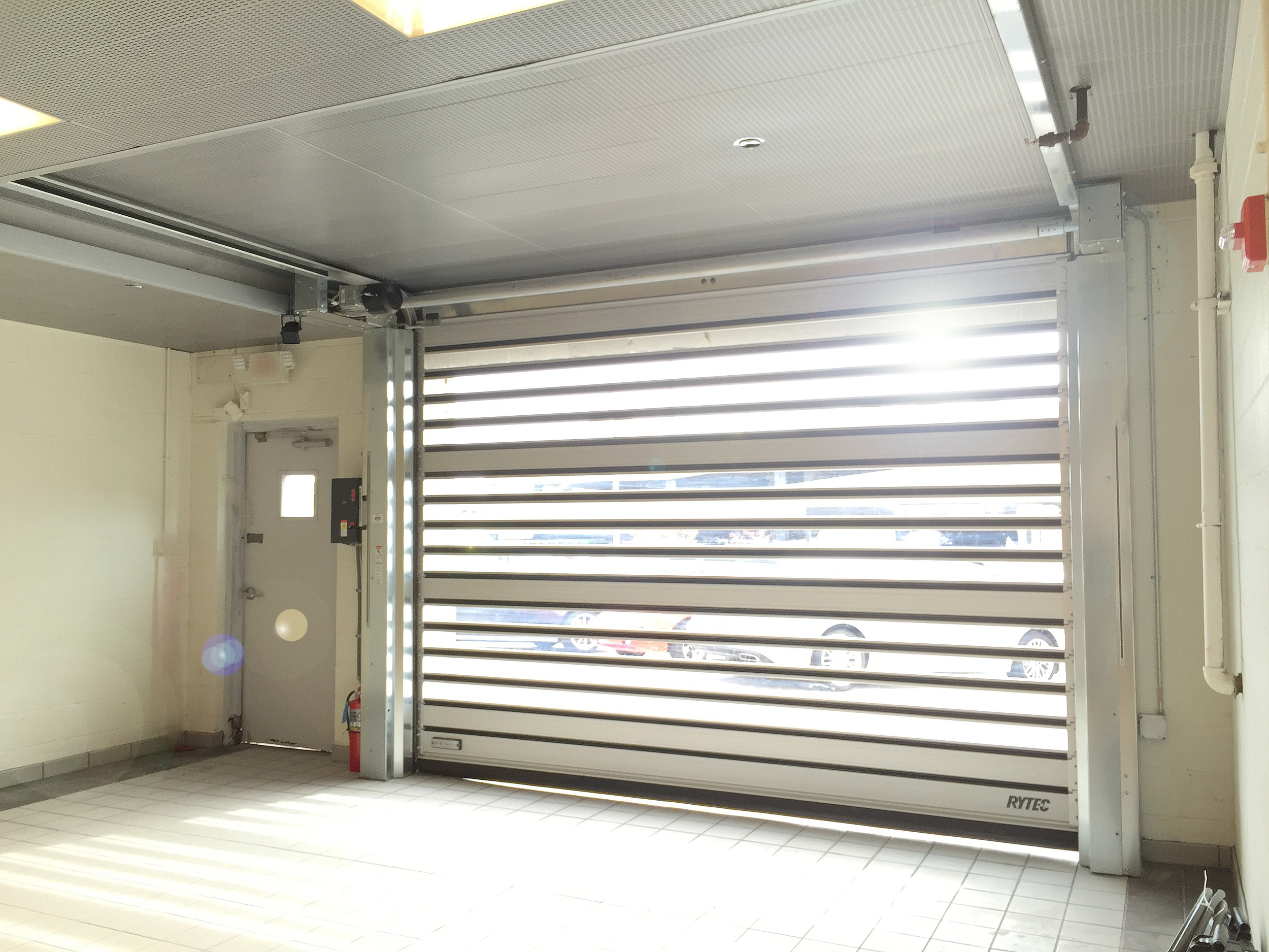 Rytec LH (Low Headroom) High Speed Door. If you've got SUPER TIGHT clearance requirements (see above image), we've got a door for your application.