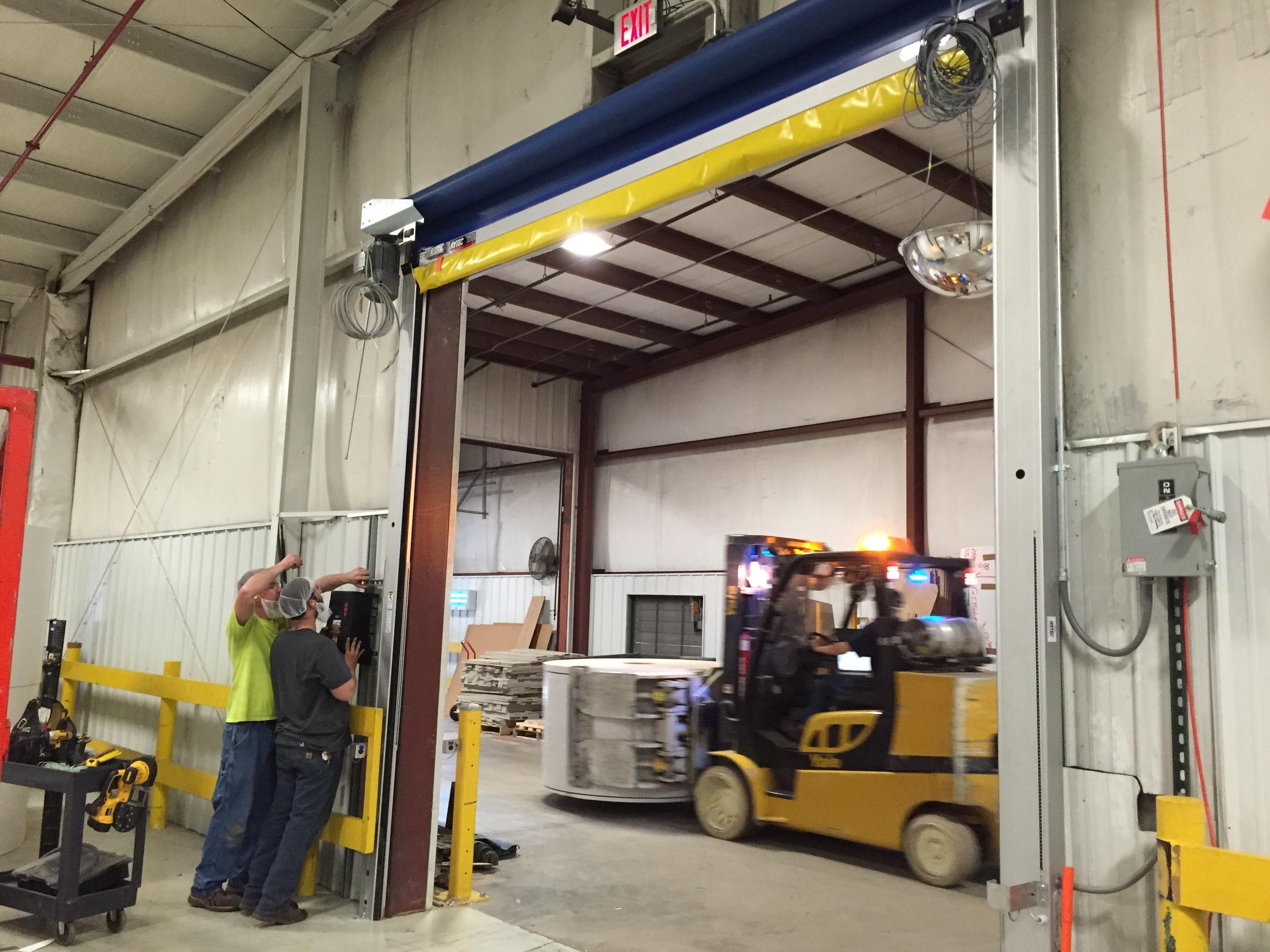 Click image to learn more about turnkey installation of high-speed doors
