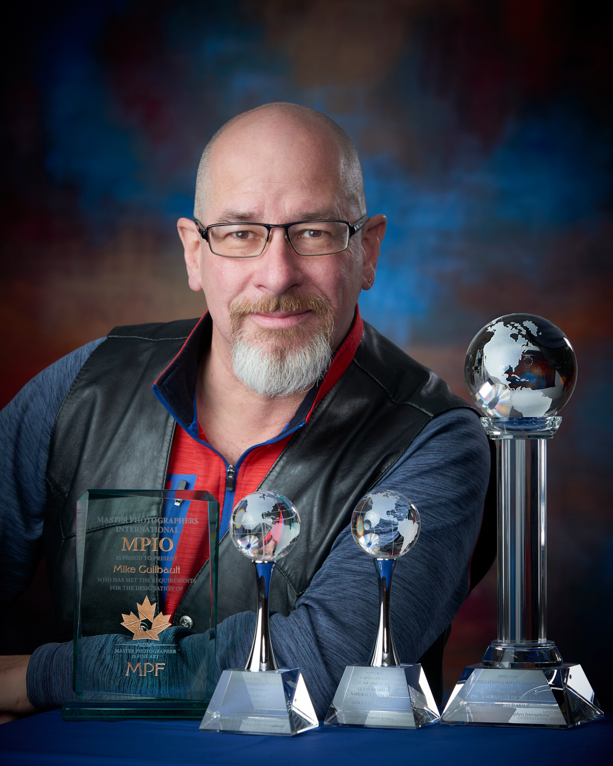 Mike Guilbault shown with (from left to right) the Master Photographer in Fine Art Award, the Best in Class (Seascape), Best in Class (Landscape) and the 2016 Nature Photographer of the Year awards from MPIO.