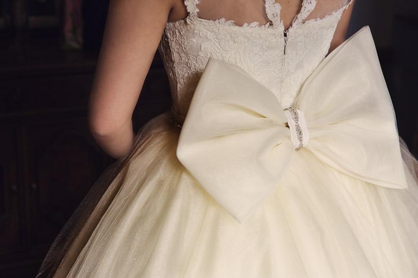 Moe had a custom made skirt for her ceremony with a jeweled belt and bow on back. What a beautiful wedding dress.