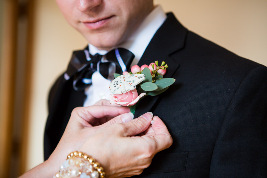Chris' Mom had a boutonniere made to reflect his love of Star Wars on his wedding day