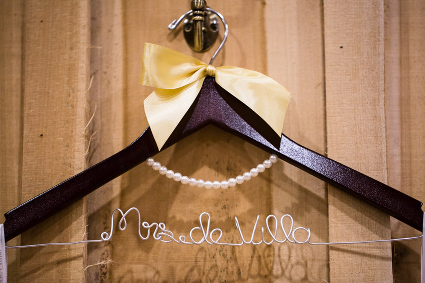 Custom Wedding Dress Hanger on the wall with yellow ribbon