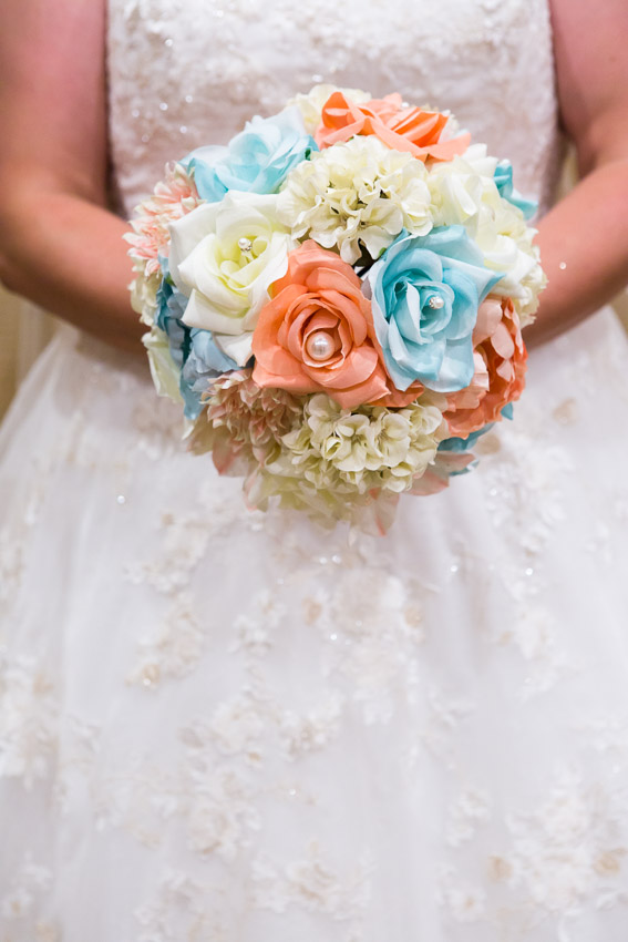 Bride holding her bouquet that she made