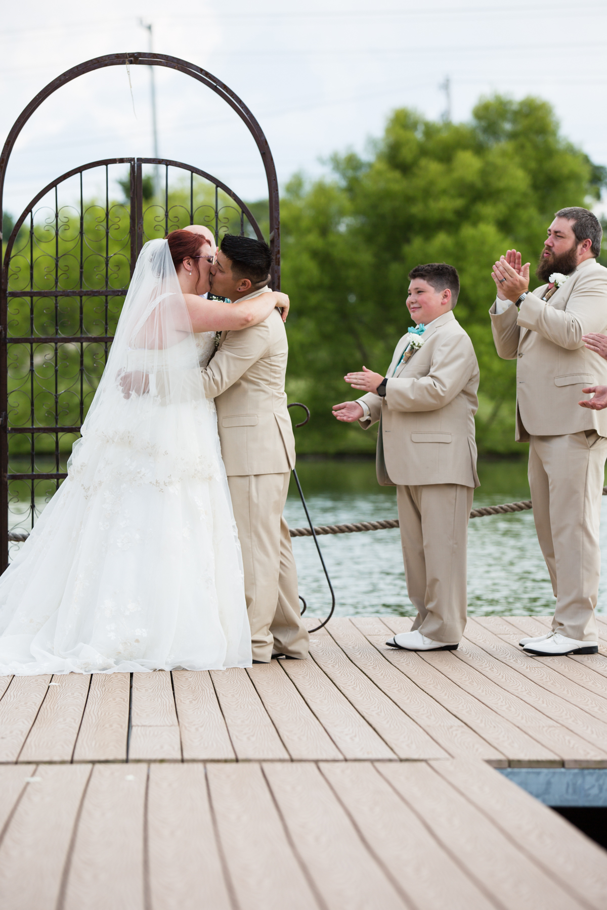 Couples first kiss lakeside ceremony