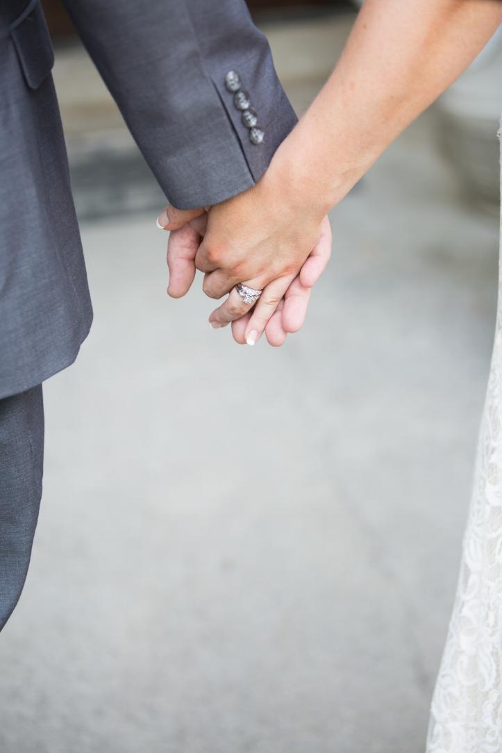 Bride-and-groom-holding-hands.jpg