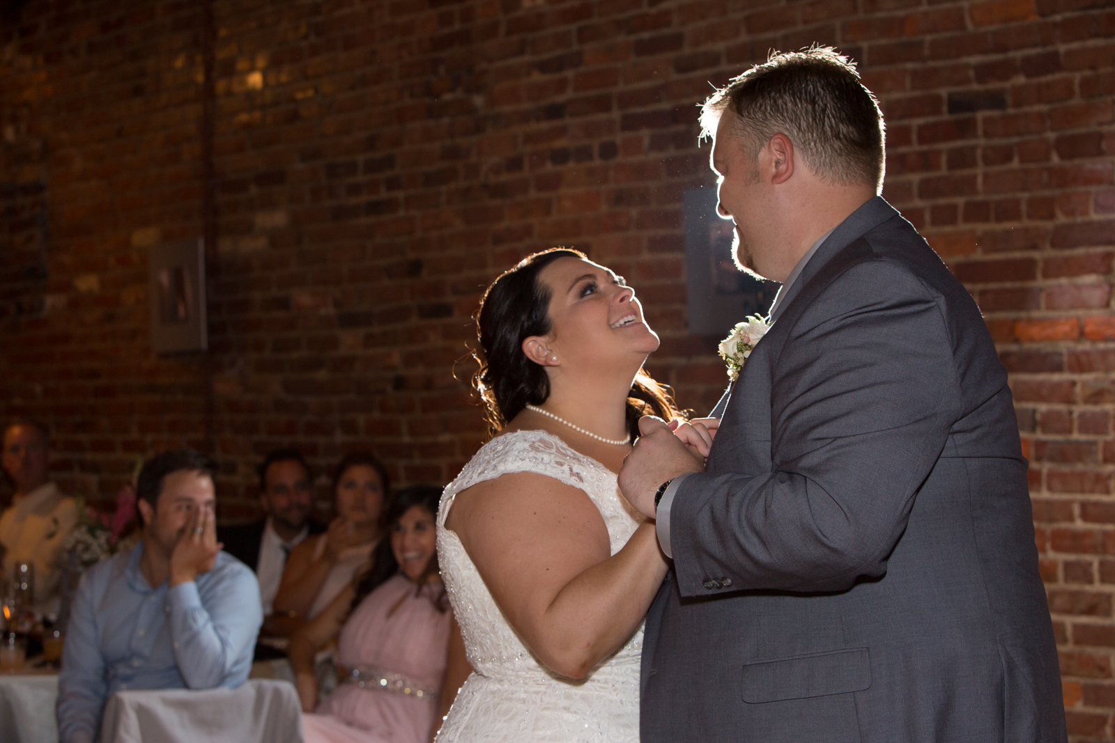The Horton Building  in Nashville with its beautiful brick walls and reclaimed wood floors is a beautiful venue for a wedding reception. Jen and Taylor had a very sweet and romantic first dance.