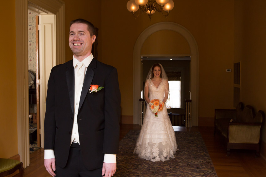 Groom smiling for first look
