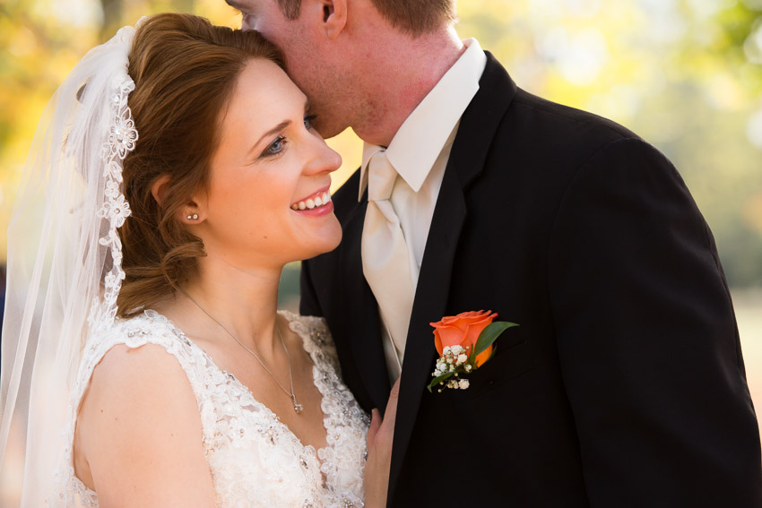 Bride smiling at what groom is saying