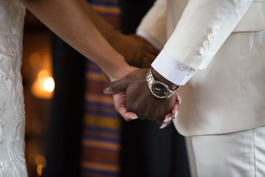 holding-hands-at-alter.jpg