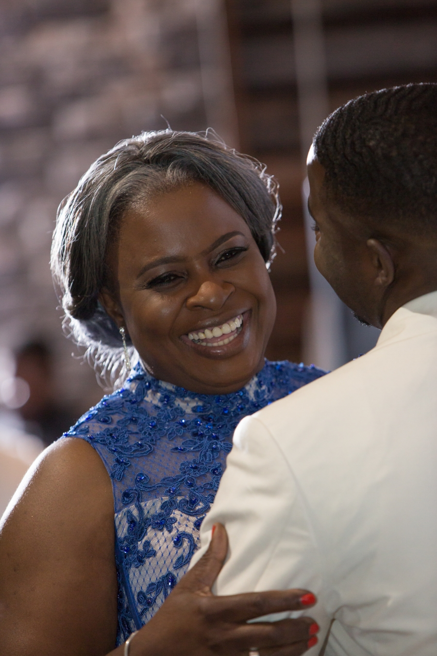 mother-smiling-dancing-with-son-wedding.jpg