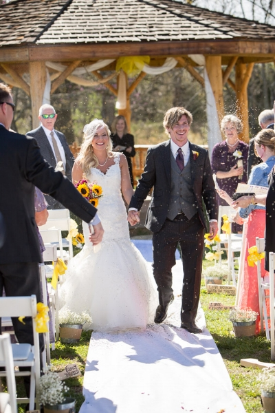 guests-tossing-seed-at-bride-and-groom.jpg