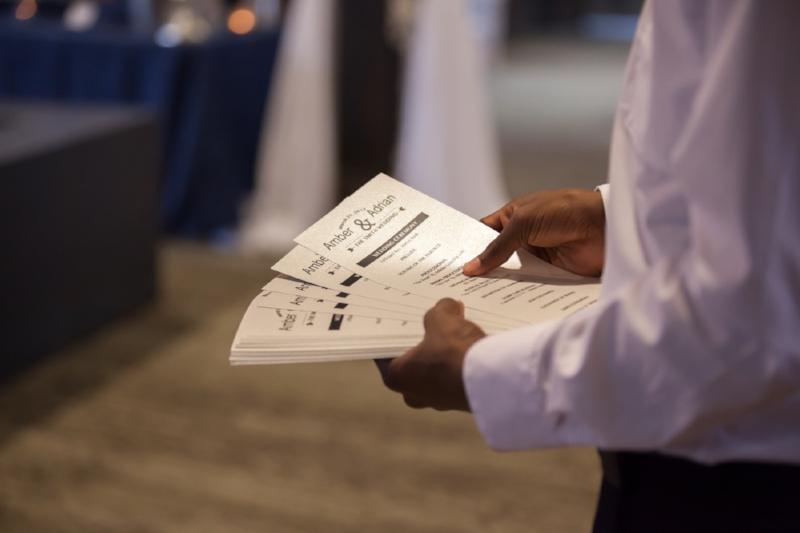 Usher with wedding programs