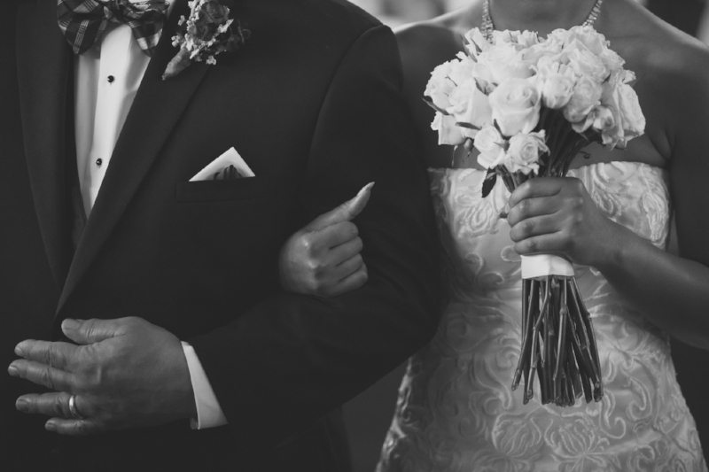 bride hand in hand with father