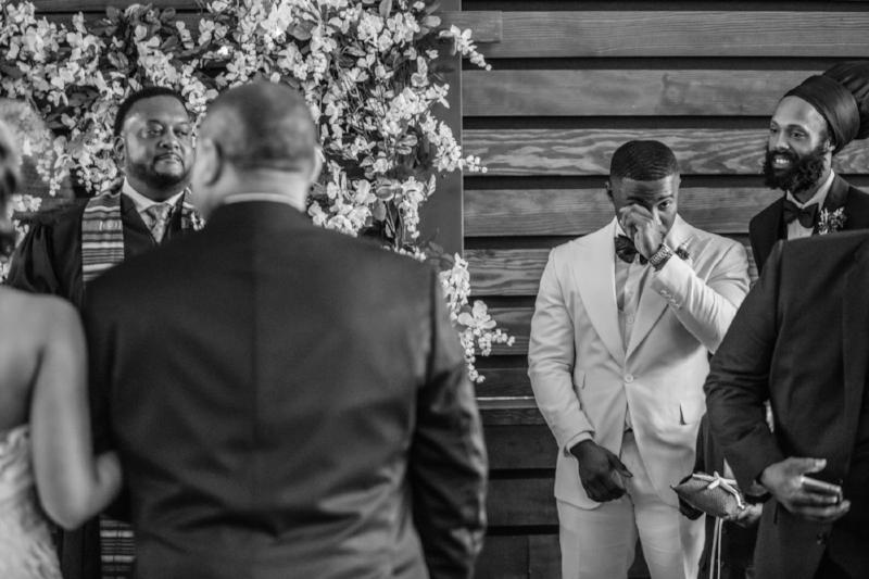 Groom reacting to seeing bride
