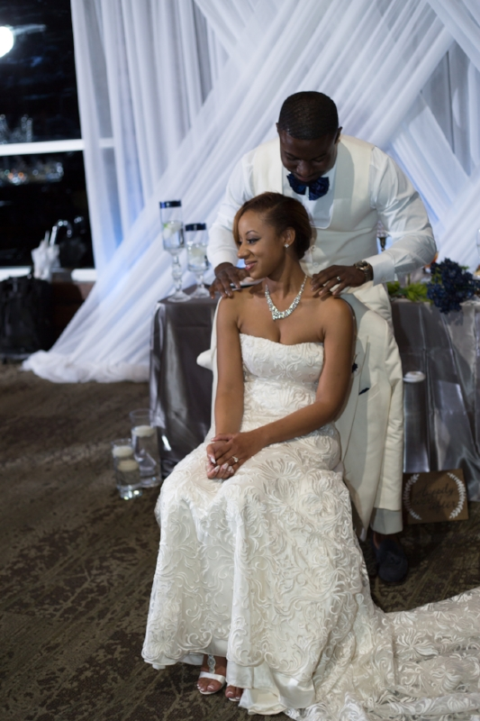 groom prepping for removal of garter