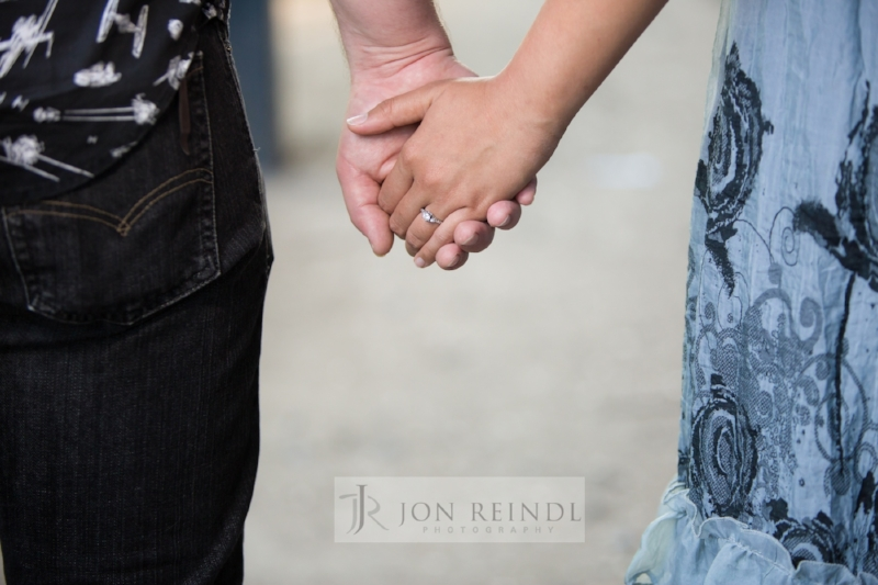 engaged-and-holding-hands-wedding-ring.jpg