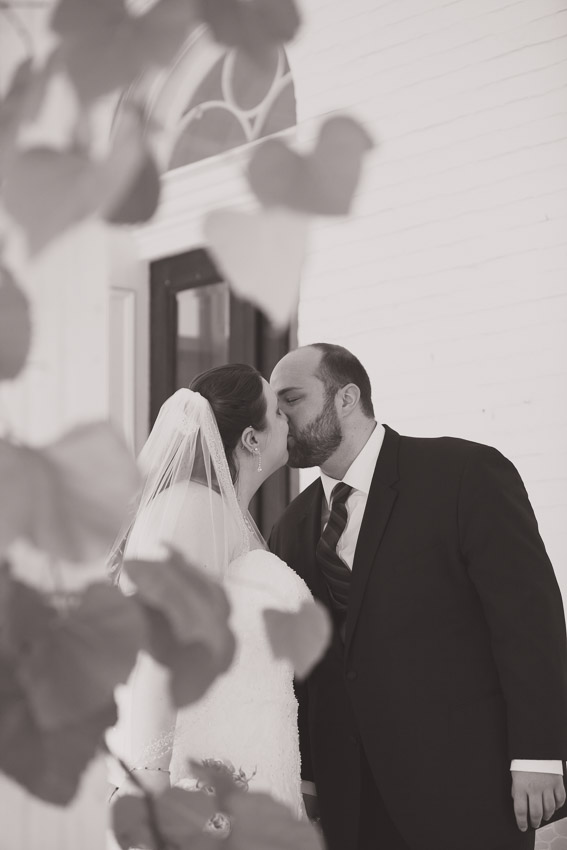 Couple kissing wedding day first look