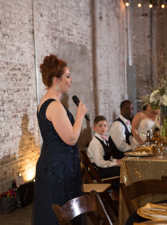 Maid of honor toasting the couple