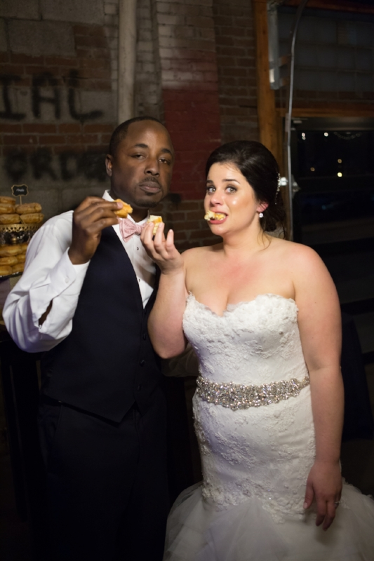 sharing a donut as husband and wife