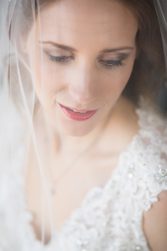 On the wedding day, we like to take a few moments alone with the Bride before she gets married. Once the dress is on, makeup applied, hair perfect and veil in place, it is a great opportunity for her to relax and just breathe for a moment and we can capture exquisite Bridal Portraits like this one.